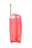 Isolerat rosa bagage Arkivfoto