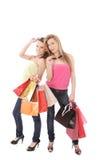 Isolerat två shoppa kvinnor Fotografering för Bildbyråer