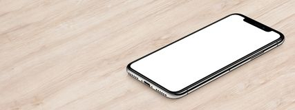 Isometric black smartphone similar to iPhone X mockup lies on wooden office desk banner with copy space. Isometric smartphone similar to iPhone X mockup lies on royalty free stock photography