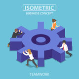 Isometric business team pushing a big cogwheel. Stock Photography
