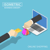 Isometric businessman hand use credit card to shopping online. Stock Photos