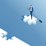 Isometric businessman and puzzle. Isometric businessman floats on the last piece of the puzzle. Business concept Stock Image