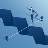 Isometric businessman tightrope walker. Isometric businessman is walking a tightrope across the gap in the earth, employee of the tightrope walker is walking a Royalty Free Stock Image