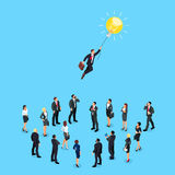 Isometric concept of a business idea. Businessman flying on light bulb over a crowd of people. 3d businesspeople  on blue background. Vector illustration Stock Images