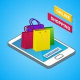 Isometric smartphone z kolorowymi torba na zakupy Zdjęcia Royalty Free
