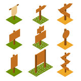 Isometric wooden pointers on grass. Stock Image