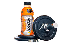 Isostar drink. ZAGREB , CROATIA - FEBRUARY 1 ,2014 :  bottle of isotonic sport drink Isostar on white background with weights Stock Photo