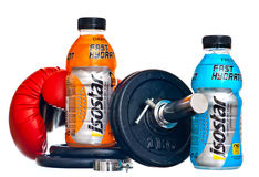 Isostar drink. ZAGREB , CROATIA - FEBRUARY 1 ,2014 :  bottles of isotonic sport drink Isostar on white background with weights Royalty Free Stock Images