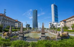 Isozaki and Hadid Towers seen from the Four seasons fountain, Giulio Cesare Square, 3 Torri, Milan, Italy. Europe royalty free stock photography