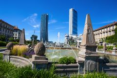 Isozaki and Hadid Towers seen from the Four seasons fountain, Giulio Cesare Square, 3 Torri, Milan, Italy. Europe royalty free stock photos