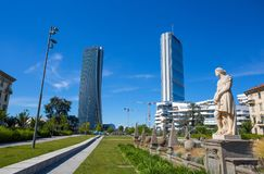 Isozaki and Hadid Towers seen from the Four seasons fountain, Giulio Cesare Square, 3 Torri, Milan, Italy. Europe royalty free stock photo