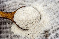Psyllium husk also known as isubgol in wooden scoop Stock Image