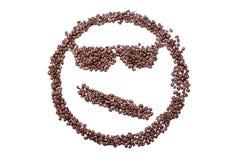 Ispectacled rritated le smiley confus des grains de café d'isolement sur le fond blanc Photographie stock libre de droits