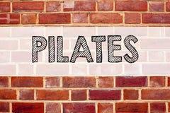 Ispirazione concettuale di titolo del testo di annuncio che mostra Pilates Concetto di affari per l'esercizio di allenamento dell Fotografia Stock Libera da Diritti