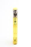Isqueiro de gás plástico amarelo Imagem de Stock