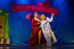 Israel, Beer-Sheva -The actor and actress in colored cloak at the theater, 2015. Youth Palace in the old town Stock Image