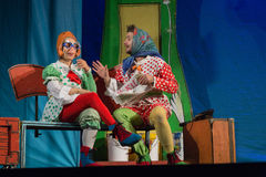 Israel, Beer-Sheva -The actor and actress in a scarf in orange hard hat and glasses on the stage of children's theater, 2015 Royalty Free Stock Photography