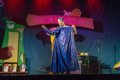 Israel, Beer-Sheva - An actor on the stage in blue raincoat 2015 Royalty Free Stock Photo