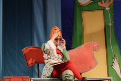 Israel, Beer-Sheva -children's theater actress on stage in a mask and glasses, 2015 Royalty Free Stock Images