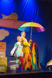 Israel, Beer-Sheva, Negev - actresses and actors of children's theater on the stage with a large umbrella, 2015. Actor and actress with a bright colored umbrella Stock Images