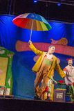 Israel, Beer-Sheva, Negev -Two actors of children's theater on the stage with a large umbrella, 2015. Actor Royalty Free Stock Image