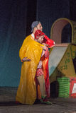 Israel, Beer-Sheva - Two actors on the stage in a yellow raincoat 2015 Stock Photos