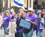 Israel day parade 2011. Marchers holding flags and banners Stock Image