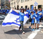 Israel Day Parade 2015. A woman holding an Israeli flag marching on Fifth Avenue in Manhattan, Celebrating New York's annual parade of Israel Royalty Free Stock Photography