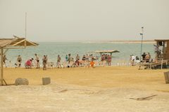 Israel, Dead Sea, June 2018: people rest in the water of the dea. D sea on the beach of Ein Gedi stock photography