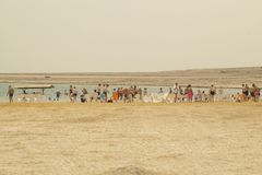 Israel, Dead Sea, June 2018: people rest in the water of the dea. D sea on the beach of Ein Gedi royalty free stock photo