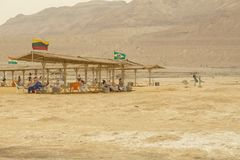 Israel, Dead Sea, June 2018: people rest in the water of the dea. D sea on the beach of Ein Gedi royalty free stock images