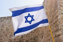 Israel Flag Against Western Wall in Jerusalem.  stock photography