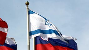 Israel flag in the center of flags group stock footage
