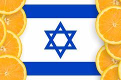 Israel flag in citrus fruit slices vertical frame. Israel flag in vertical frame of orange citrus fruit slices. Concept of growing as well as import and export stock photos