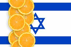 Israel flag and citrus fruit slices vertical row. Israel flag and vertical row of orange citrus fruit slices. Concept of growing as well as import and export of royalty free stock photos