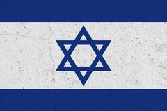 Israel flag on concrete wall. Patriotic grunge background. National flag of Israel stock photos
