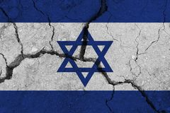 Israel flag on the cracked earth. National flag of Israel. Earthquake or drought concept royalty free stock images