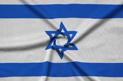 Israel flag is depicted on a sports cloth fabric with many folds. Sport team banner. Israel flag is depicted on a sports cloth fabric with many folds. Sport team royalty free stock photo