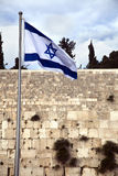 Israel Flag & The Wailing Wall. Israel flag fluttering in the wind in front of the holy Wailing Wall, one of the most sacred places to the Jewish people stock images