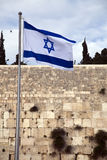 Israel Flag & The Wailing Wall. Israel flag fluttering in the wind in front of the holy Wailing Wall, one of the most sacred places to the Jewish people Stock Image