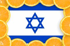 Israel flag in fresh citrus fruit slices frame. Israel flag in frame of orange citrus fruit slices. Concept of growing as well as import and export of citrus royalty free stock photos