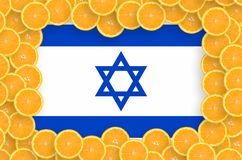 Israel flag in fresh citrus fruit slices frame. Israel flag in frame of orange citrus fruit slices. Concept of growing as well as import and export of citrus stock photo