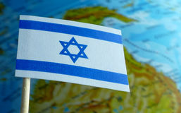 Israel flag with a globe map as a background Stock Photos