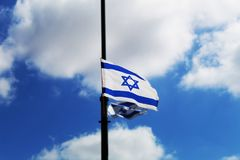 Israel flag hung in honor of the Independence Day of Israel against the blue sky royalty free stock photo
