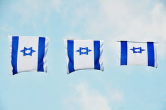Israel Flag on Independence Day. Israel flag in white and blue showing the Star of David hanging proudly for Israel's Independence Day (Yom Haatzmaut stock photos