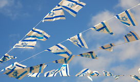Israel Flag on Independence Day. Israel flag in white and blue showing the Star of David hanging proudly for Israel's Independence Day (Yom Haatzmaut royalty free stock photo