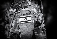 Israel flag on soldiers arm collage.  stock photo