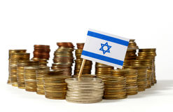 Israel flag with stack of money coins. Israel flag waving with stack of money coins royalty free stock photography