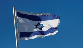 Israel flag waving against a blue sky Royalty Free Stock Image