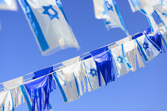 Israel flags. In a chain over blue sky. Independence Day Royalty Free Stock Photo